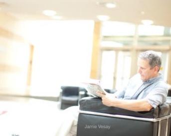 Jamie Vesay sitting writing notes WM IMG_7682 (1)